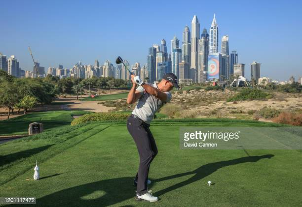Henrik Stenson of Sweden plays a shot from the eighth tee during the proam as a preview for the Omega Dubai Desert Classic on the Majlis Course at...