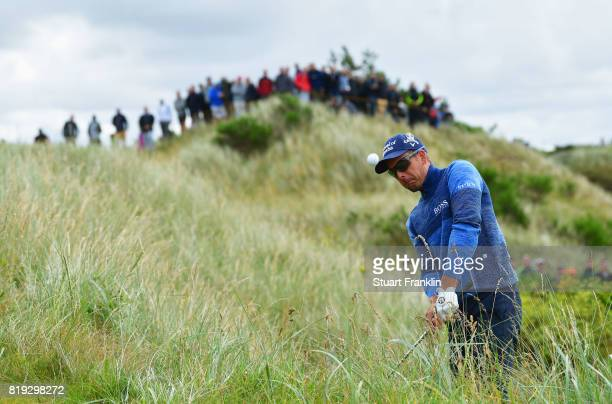 Henrik Stenson of Sweden plays a shot from the rough on the 6th hole during the first round of the 146th Open Championship at Royal Birkdale on July...