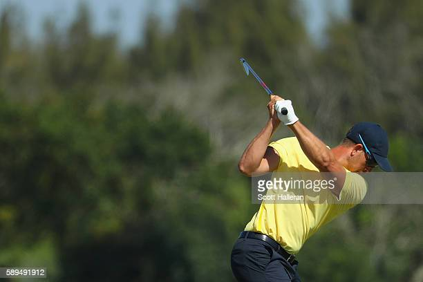 Henrik Stenson of Sweden plays a shot on the 12th hole during the final round of men's golf on Day 9 of the Rio 2016 Olympic Games at the Olympic...