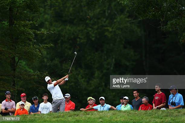 Henrik Stenson of Sweden plays a shot on the 13th hole during the final round of the Deutsche Bank Championship at TPC Boston on September 2, 2013 in...