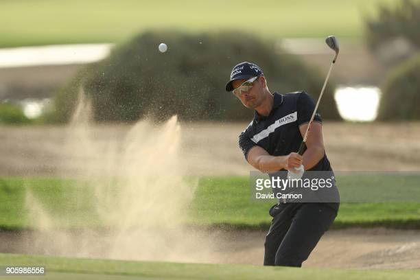 Henrik Stenson of Sweden plays a shot on the 14th hole during the pro-am for the 2018 Abu Dhabi HSBC Golf Championship at the Abu Dhabi Golf Club on...