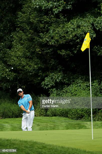 Henrik Stenson of Sweden plays a shot to the fourth green during the third round of The Barclays at The Ridgewood Country Club on August 23 2014 in...