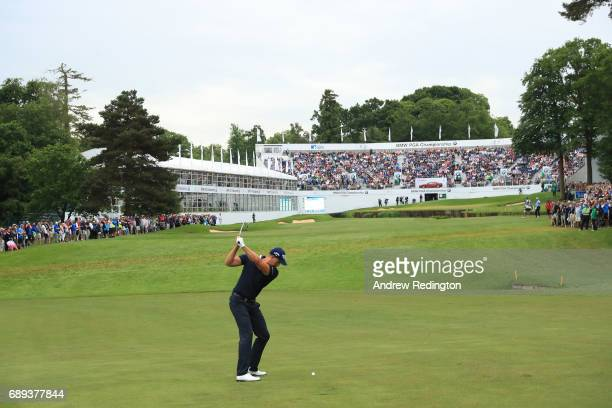 Henrik Stenson of Sweden plays an approach on the 18th hole during the final round on day four of the BMW PGA Championship at Wentworth on May 28...