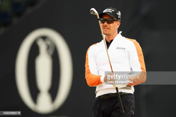 Henrik Stenson of Sweden plays at the 1st hole while playing in a practice round during previews to the 147th Open Championship at Carnoustie Golf...