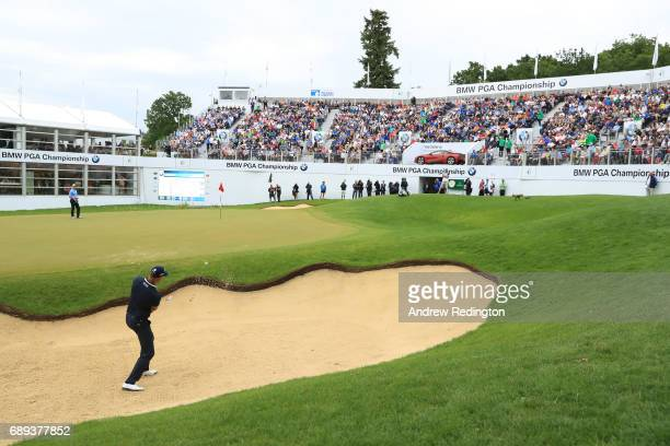 Henrik Stenson of Sweden plays from a bunker on the 18th hole during the final round on day four of the BMW PGA Championship at Wentworth on May 28...