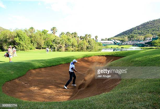 Henrik Stenson of Sweden plays from the bunker on the 18th during the third round of the Nedbank Golf Challenge at Gary Player CC on December 5 2015...