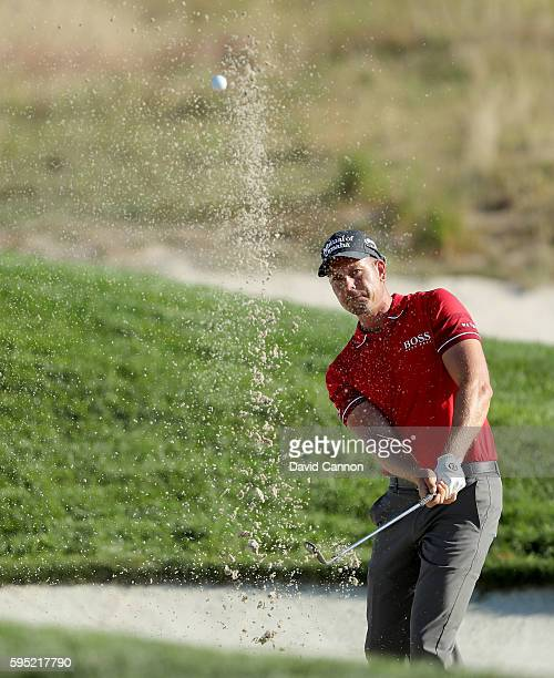 Henrik Stenson of Sweden plays his fourth shot on the 11th hole during the first round of The Barclays in the PGA Tour FedExCup PlayOffs on the Black...