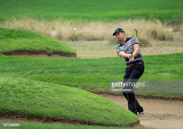 Henrik Stenson of Sweden plays his second shot at the par 3 second hole during the first round of the 2013 Turkish Airlines Open on the Montgomerie...