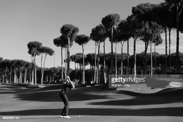 Henrik Stenson of Sweden plays his second shot into the 11h green during the first round of the Turkish Airlines Open at the Regnum Carya Golf Spa...
