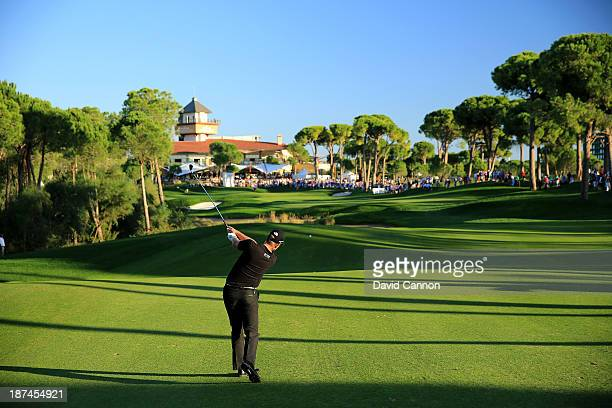 Henrik Stenson of Sweden plays his second shot on the par 5 18th hole during the third round of the 2013 Turkish Airlines Open on the Montgomerie...