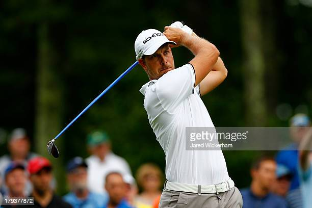 Henrik Stenson of Sweden plays his shot from the 12th tee during the final round of the Deutsche Bank Championship at TPC Boston on September 2, 2013...