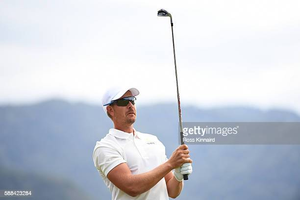 Henrik Stenson of Sweden plays his shot from the fourth tee during the first round of men's golf on Day 6 of the Rio 2016 Olympics at the Olympic...