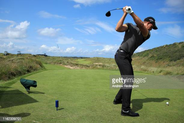 Henrik Stenson of Sweden plays his shot from the seventh tee during a practice round prior to the 148th Open Championship held on the Dunluce Links...