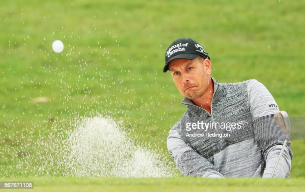 Henrik Stenson of Sweden plays his third shot from a bunker on the 14th hole during the final round of the WGC HSBC Champions at Sheshan...