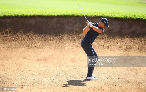 Henrik Stenson of Sweden plays out of the 10th fairway bunker during the third round of the Nedbank Golf Challenge hosted by Gary Player at the Gary...