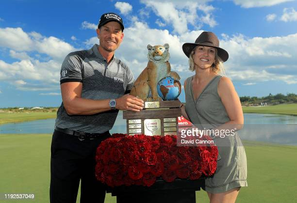 Henrik Stenson of Sweden poses with his wife Emma Stenson and the trophy after the final round of the 2019 Hero World Challenge at Albany on December...