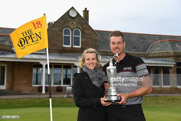 Henrik Stenson of Sweden poses with his wife Emma Stenson and the Claret Jug following his victory during the final round on day four of the 145th...