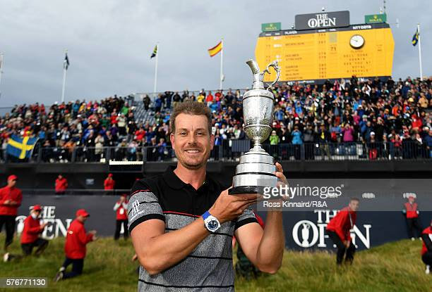 Henrik Stenson of Sweden poses with the Claret Jug on the 18th green following his victory during the final round on day four of the 145th Open...