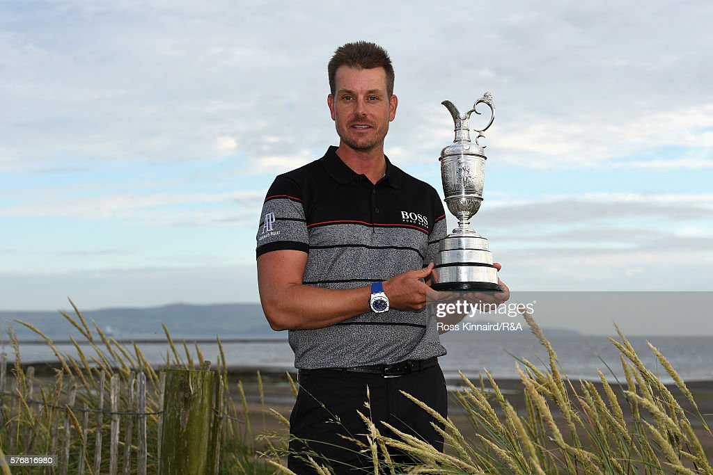 Henrik Stenson of Sweden poses with the Claret Jug on Troon Beach following his victory during the final round on day four of the 145th Open Championship at Royal Troon on July 17, 2016 in Troon, Scotland.