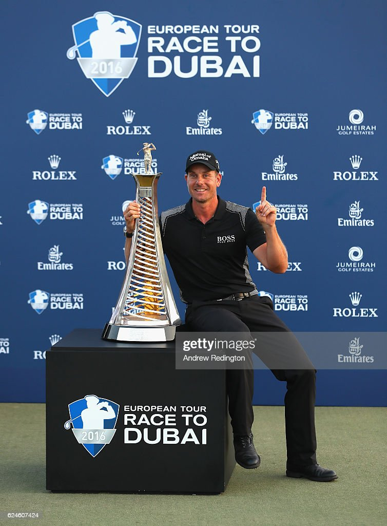 Henrik Stenson of Sweden poses with the Race To Dubai trophy after winning the Race To Dubai at the DP World Tour Championship on the Earth Course at Jumeirah Golf Estates on November 20, 2016 in Dubai, United Arab Emirates.