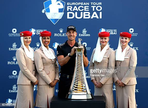 Henrik Stenson of Sweden poses with the Race to Dubai trophy and Emirates girls after the DP World Tour Championship on the at Jumeirah Golf Estates...