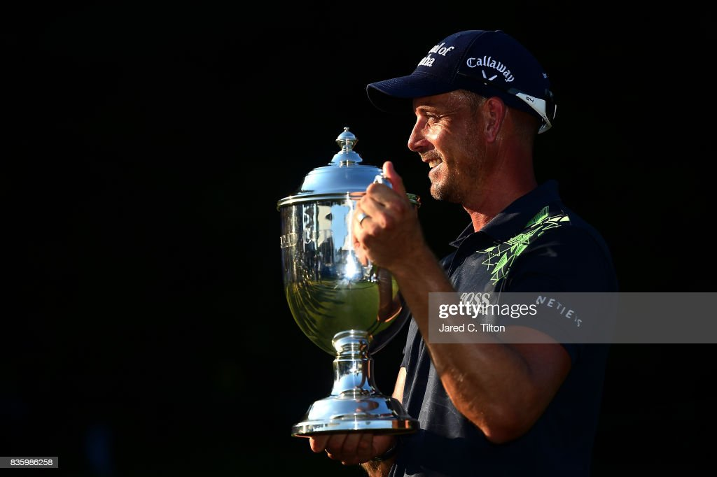 Henrik Stenson of Sweden poses with the trophy after winning the Wyndham Championship at Sedgefield Country Club on August 20, 2017 in Greensboro, North Carolina.
