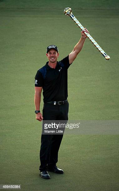 Henrik Stenson of Sweden poses with the trophy after winning the DP World Tour Championship at Jumeirah Golf Estates on November 23, 2014 in Dubai,...