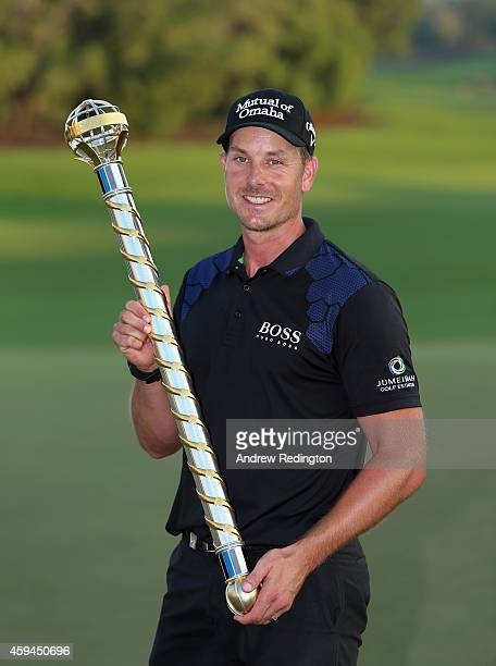 Henrik Stenson of Sweden poses with the trophy after winning the DP World Tour Championship at Jumeirah Golf Estates on November 23 2014 in Dubai...