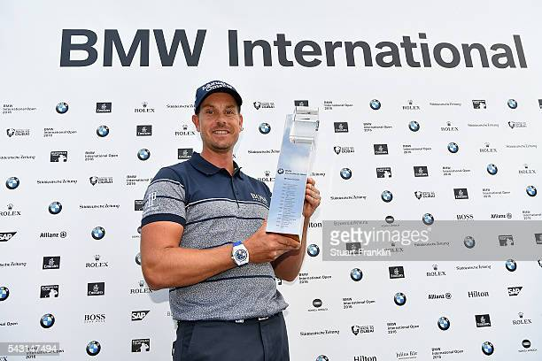 Henrik Stenson of Sweden poses with the trophy following his 3 shot victory during the final round of the BMW International Open at Gut Larchenhof on...