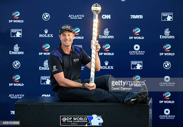 Henrik Stenson of Sweden proudly holds the DP World Tour Championship trophy after his two shot victory during the final round of the 2014 DP World...