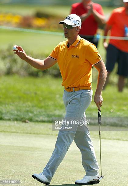 Henrik Stenson of Sweden reacts after a birdie putt on the first green during the final round of the Valspar Championship at Innisbrook Resort...