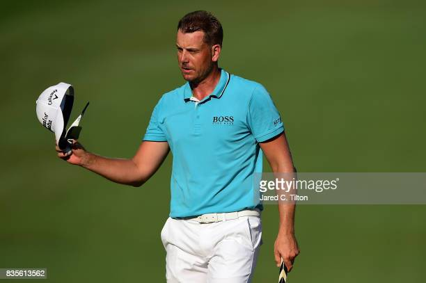 Henrik Stenson of Sweden reacts after making his birdie putt on the 18th green during the third round of the Wyndham Championship at Sedgefield...