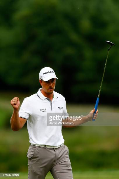 Henrik Stenson of Sweden reacts after putting for birdie on the 11th green during the final round of the Deutsche Bank Championship at TPC Boston on...