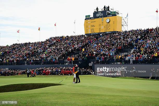 Henrik Stenson of Sweden reacts on the 18th green with caddie Gareth Lord after holing a putt for victory during the final round on day four of the...