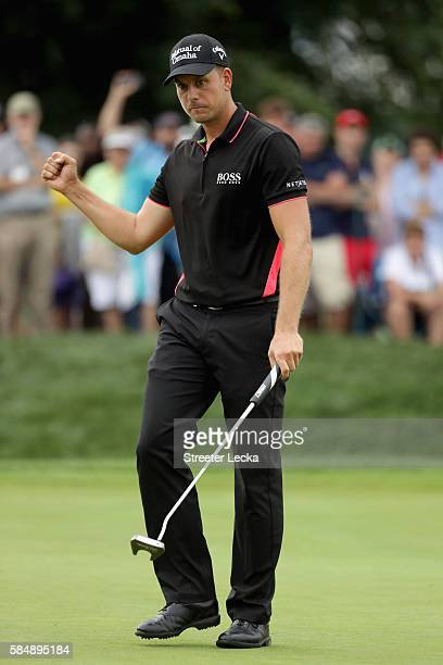 Henrik Stenson of Sweden reacts to a putt for birdie on the sixth green during the final round of the 2016 PGA Championship at Baltusrol Golf Club on...
