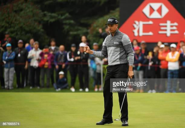 Henrik Stenson of Sweden reacts to his birdie on the 12th green during the final round of the WGC HSBC Champions at Sheshan International Golf Club...