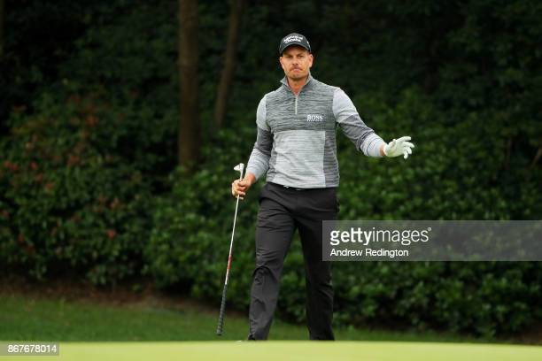 Henrik Stenson of Sweden reacts to his third shot on the 15th hole during the final round of the WGC HSBC Champions at Sheshan International Golf...