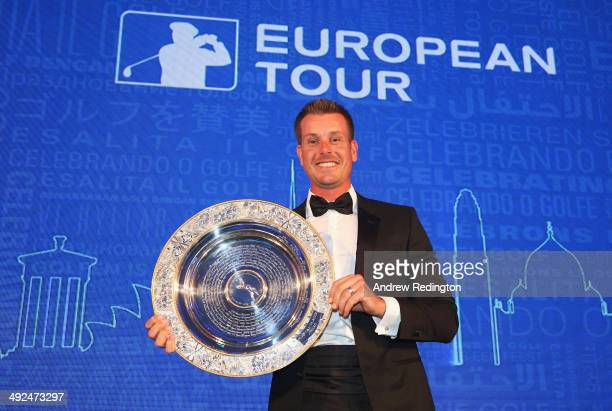 Henrik Stenson of Sweden receives the 2013 Players' Player of the Year award during the European Tour Players' Awards ahead of the BMW PGA...