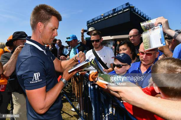 Henrik Stenson of Sweden signs autographs for fans during a practice round prior to the 146th Open Championship at Royal Birkdale on July 17 2017 in...