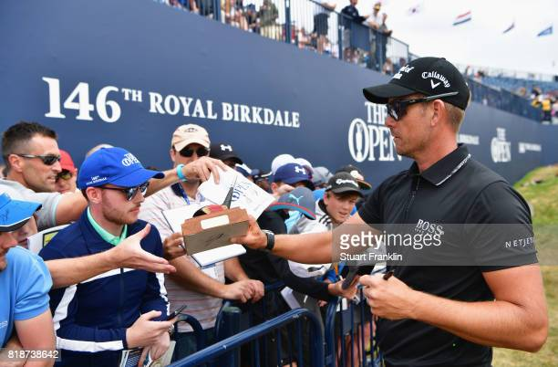 Henrik Stenson of Sweden signs autographs for fans during a practice round prior to the 146th Open Championship at Royal Birkdale on July 19 2017 in...