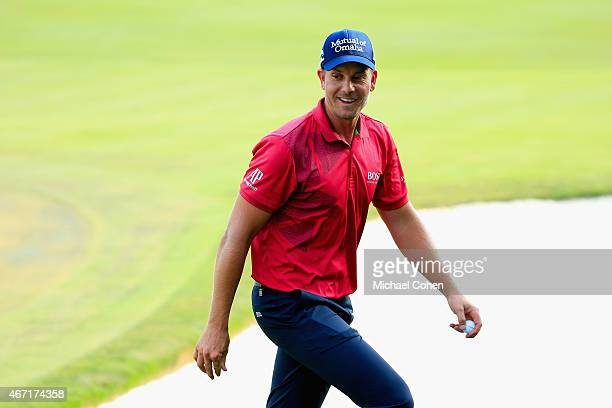 Henrik Stenson of Sweden smiles as he walks off the 18th green after the third round of the Arnold Palmer Invitational Presented By MasterCard at the...