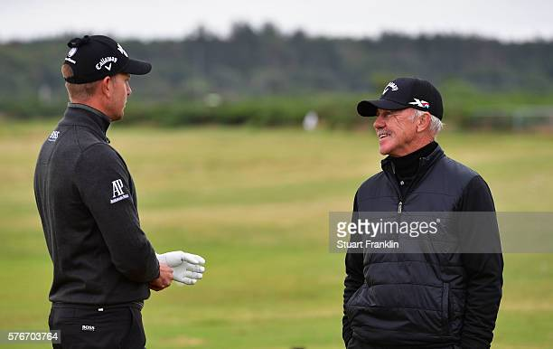 Henrik Stenson of Sweden speaks with his coach Pete Cowen on the driving range before his final round on day four of the 145th Open Championship at...