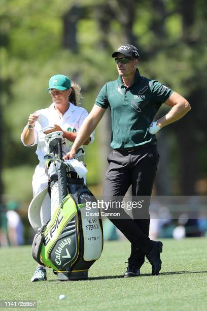 Henrik Stenson of Sweden stands with caddie Fanny Sunesson during a practice round prior to the Masters at Augusta National Golf Club on April 10...