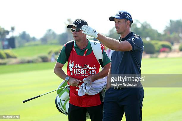 Henrik Stenson of Sweden talks to caddie Gareth Lord on the 9th hole during the first round of the Abu Dhabi HSBC Golf Championship at The Abu Dhabi...