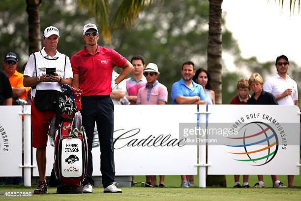 Henrik Stenson of Sweden talks with his caddie Gareth Lord on the second tee box during the third round of the World Golf ChampionshipsCadillac...