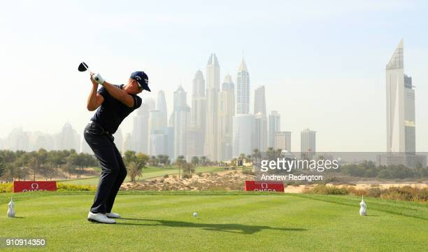 Henrik Stenson of Sweden tees off on the 8th hole with the city as a backdrop during day three of Omega Dubai Desert Classic at Emirates Golf Club on...
