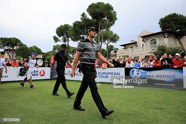 Henrik Stenson of Sweden the European Tour's 'Race to Dubai' money leader leaves the tee at the par 5 first hole followed by the World's Number One...