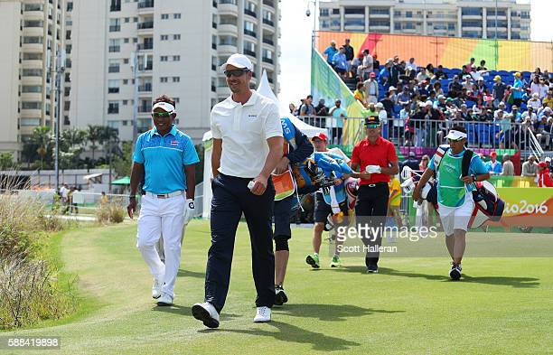 Henrik Stenson of Sweden Thongchai Jaidee of Thailand and Rafa Cabrera Bello of Spain walk from the first tee during the first round of men's golf on...