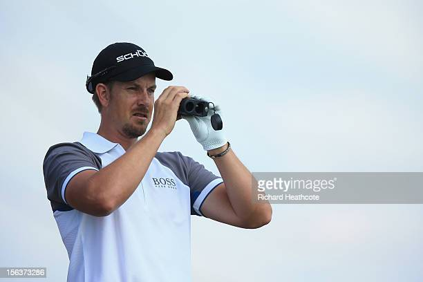 Henrik Stenson of Sweden uses a laser rangefinder during a practise round for the South African Open Championship at the Serengeti Golf Club on...