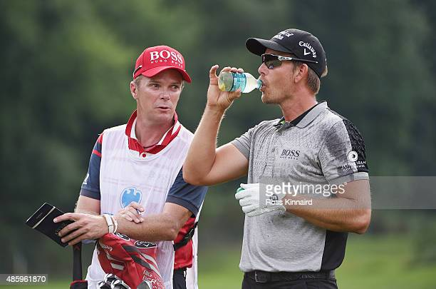 Henrik Stenson of Sweden waits alongside his caddie Gareth Lord on the 13th hole during the final round of The Barclays at Plainfield Country Club on...